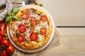 Italian cuisine: pizza with salami — Stock Photo