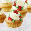 Wedding reception cupcakes decorated with sugarcraft red roses — Stock Photo #60131257