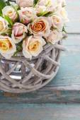 Bouquet of roses in wicker basket — Stock Photo