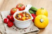 Bowl of goulash soup and fresh vegetables — Stock Photo