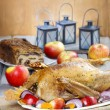 Roasted goose with apples and vegetables on wooden table. — Stock Photo #60182881