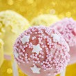 Pink and yellow cake pops decorated with sprinkles. — Stock Photo #60183047