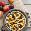 Tart with peach, pumpkin, plum, pear and blueberry in autumn set — Stock Photo #60183549