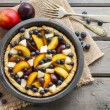 Tart with peach, pumpkin, plum, pear and blueberry in autumn set — Stock Photo #60183553