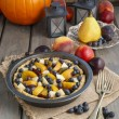 Tart with peach, pumpkin, plum, pear and blueberry in autumn set — Stock Photo #60183561