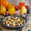 Tart with peach, pumpkin, plum, pear and blueberry in autumn set — Stock Photo #60183571