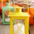 Beautiful lanterns and pumpkins on wooden table — Stock Photo #60184881