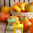 Beautiful lanterns and pumpkins on wooden table — Stock Photo #60184887