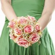 Young woman in green dress holding bouquet of pink roses — Stock Photo #60184909