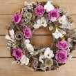 Door wreath made of artificial flowers and autumn plants on wood — Stock Photo #60185785