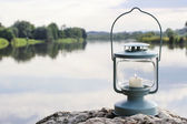 Lantern on the rock, lake in the background — Stock Photo