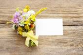 Bouquet of wild flowers on brown wooden background — Zdjęcie stockowe