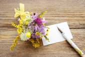 Bouquet of wild flowers on brown wooden background — Stock Photo