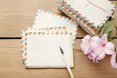 Package of vintage letters, pen and pink alstroemeria flowers — Photo