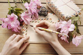Woman writing a letter — Stock Photo