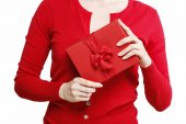 Woman holding red present box with big bow  — Stock Photo