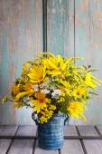 Bouquet of sunflowers and wild flowers on wooden table — Stock Photo