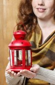 Woman holding red christmas lantern. — Stock Photo