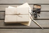 Parcel wrapped with brown paper on table — Stock Photo