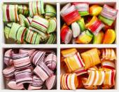 Hard candies in wooden box — Stock Photo