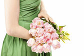 Young woman in green dress holding bouquet of pink tulips — Stock Photo