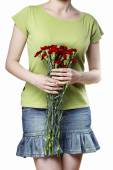 Woman holding bouquet of red carnations — Stock Photo
