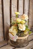 Easter floral arrangement on wooden background — Stock Photo