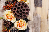 Condolences background, artificial flowers and autumn plants — Stock Photo