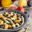 Tart with peach, pumpkin, plum, pear and blueberry — Stock Photo #60243911