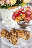 Eclairs on cake stand — Stock Photo