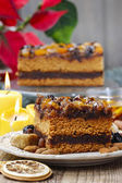 Delicious layer gingerbread cake decorated with dried fruits — Stock Photo
