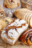 Breads and rolls on wooden table — Stock Photo