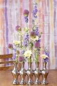 How to make floral arrangement in silver vase — Stock Photo