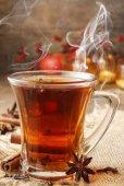Glass of christmas hot steaming tea — Stock Photo