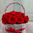 Bouquet of red roses in wicker basket — Stock Photo #60396023