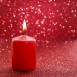Red candle. Red glittering christmas lights. — Stock Photo #60397661