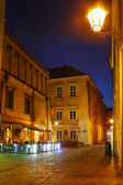 City center by night: ancient temements Krakow, Poland — Stock Photo