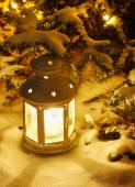 Lantern on snow — Stock Photo