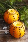 Orange pomander ball with candle — Stock Photo