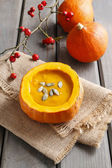 Creamy pumpkin soup on rustic wooden table — Stock Photo