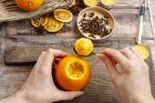 How to make orange pomander ball with candle - step by step — Stock Photo