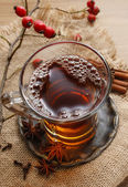 Glass of hot steaming tea — Stock Photo