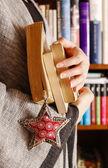 Woman holding books — Stock Photo