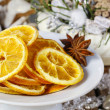 Dried oranges - decoration on a christmas table — Stock Photo #60506747