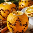 Orange pomander ball with candle, christmas decoration — Stock Photo #60507087