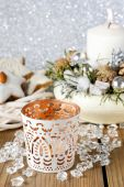 White candle holder with oriental ornaments — Stock Photo
