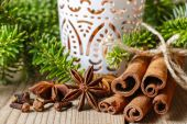Cinnamon sticks and anise stars on christmas table.  — Stock Photo
