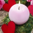 Pink candle and wooden red heart — Stock Photo #61103791