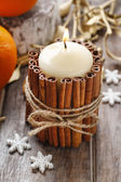 Candle decorated with cinnamon sticks, christmas decoration — Stock Photo