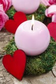 Pink candle and wooden red heart — Stock Photo